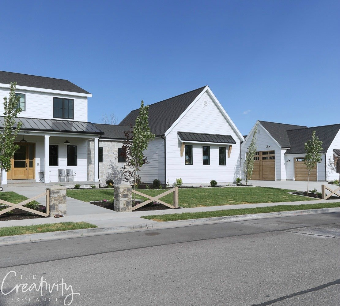 Modern farmhouse with extended garages. Millhaven Homes