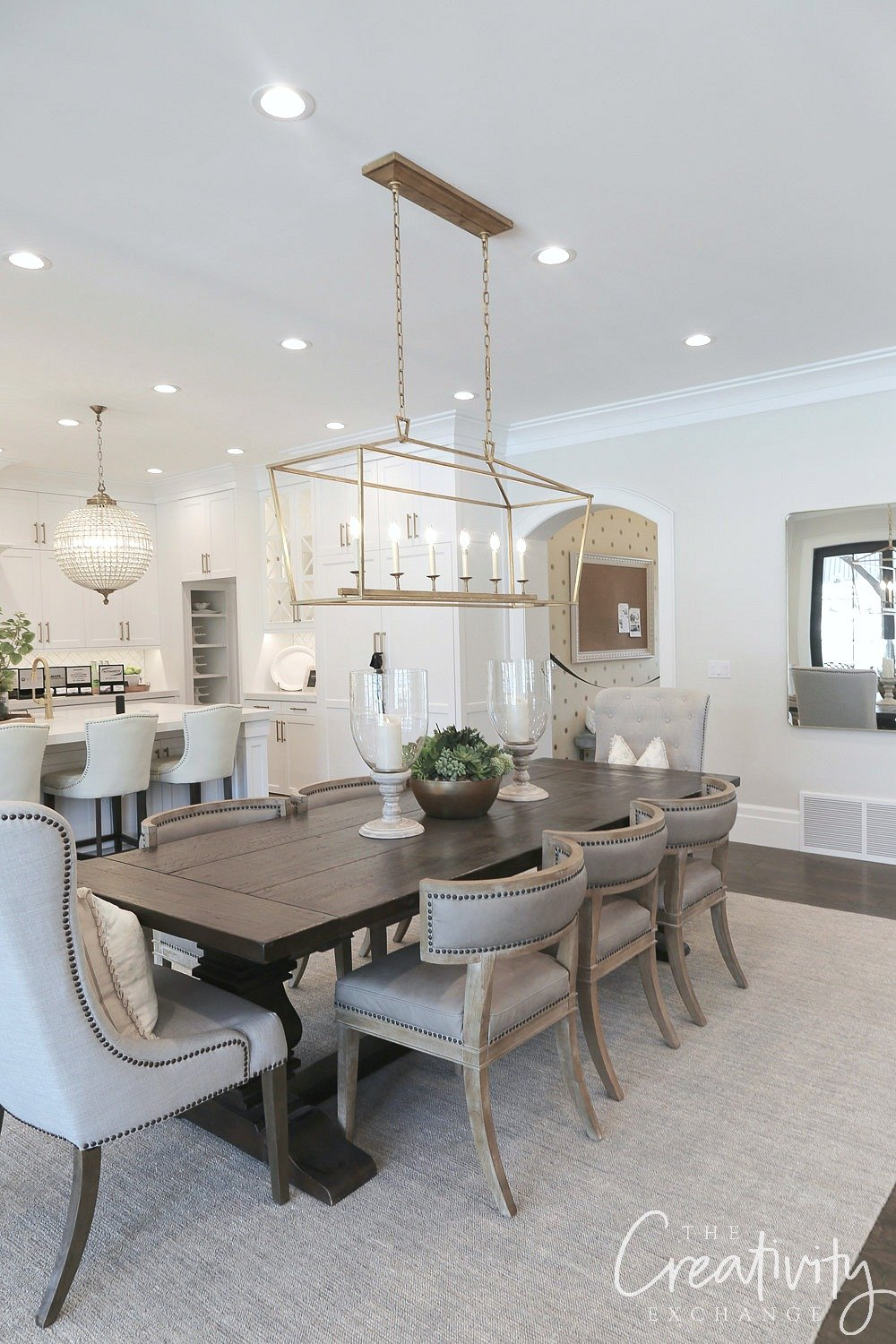 White dining with Restoration Hardware table.