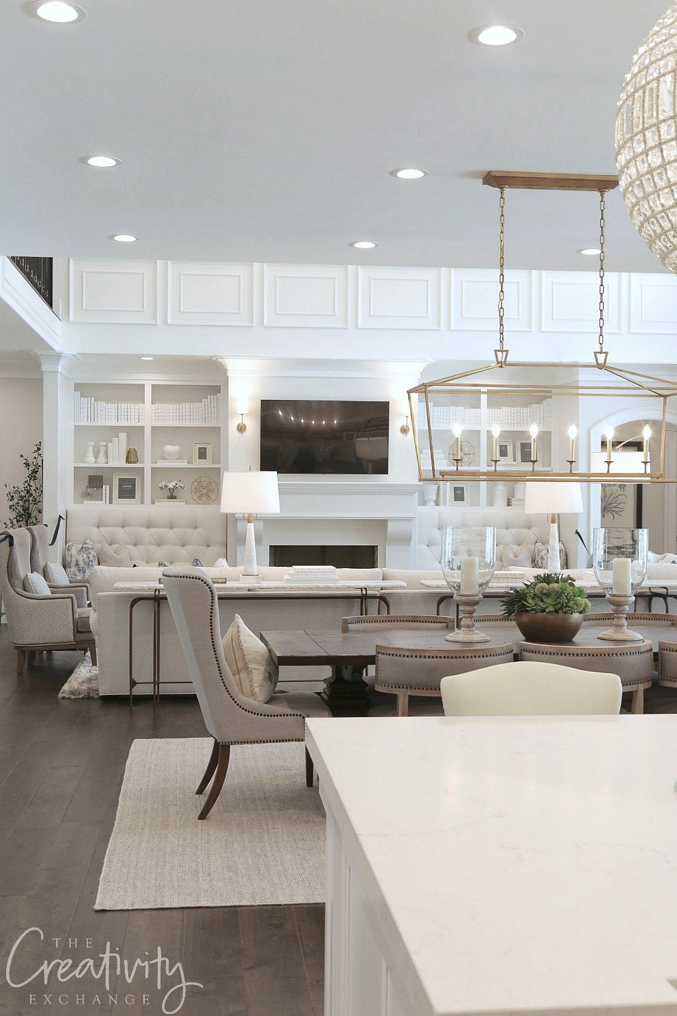 White open living room, kitchen and dining room. Shelby Homes