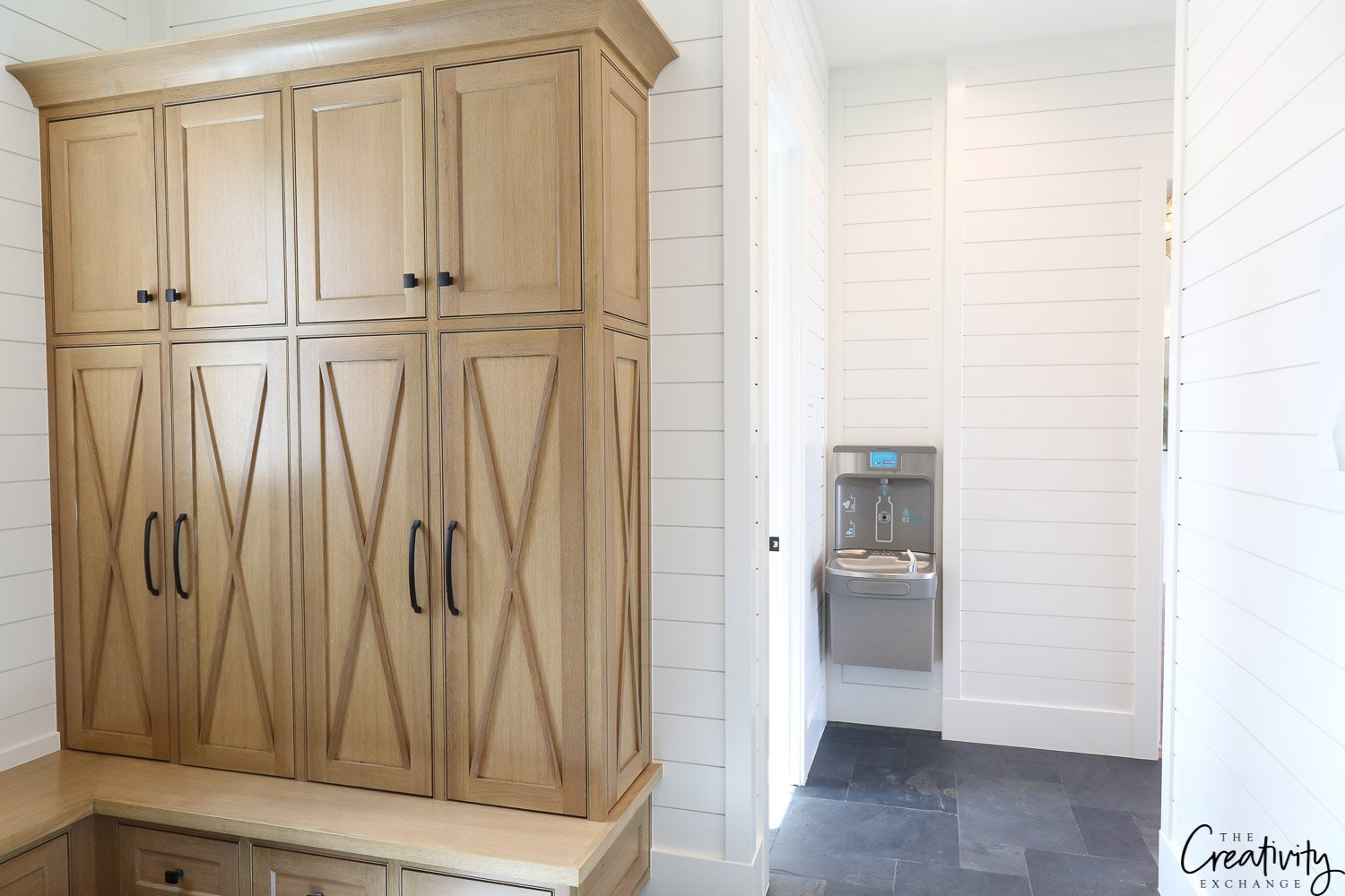 Mudroom with enclosed storage cabinets.