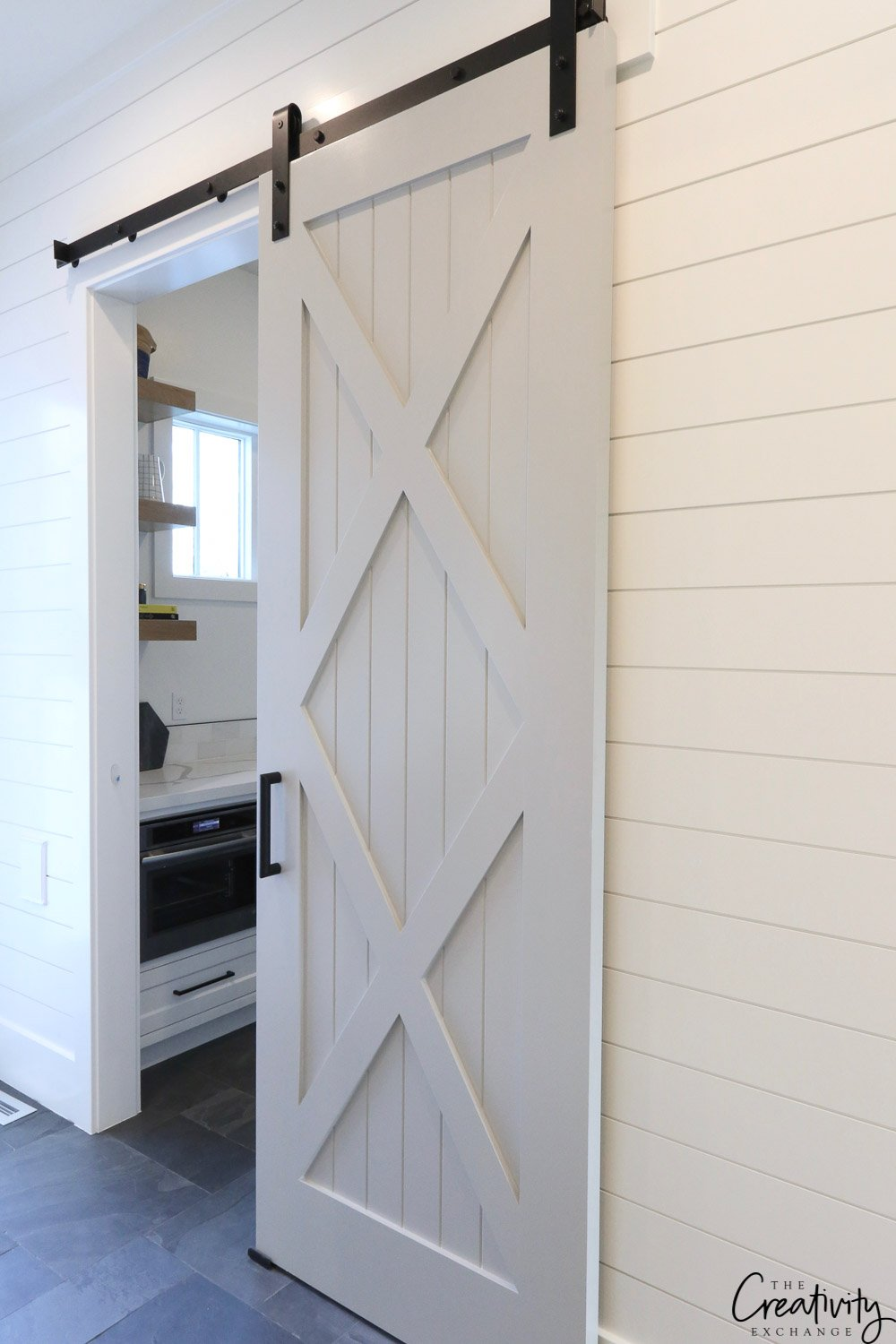 Sliding barn door to modern farmhouse pantry.
