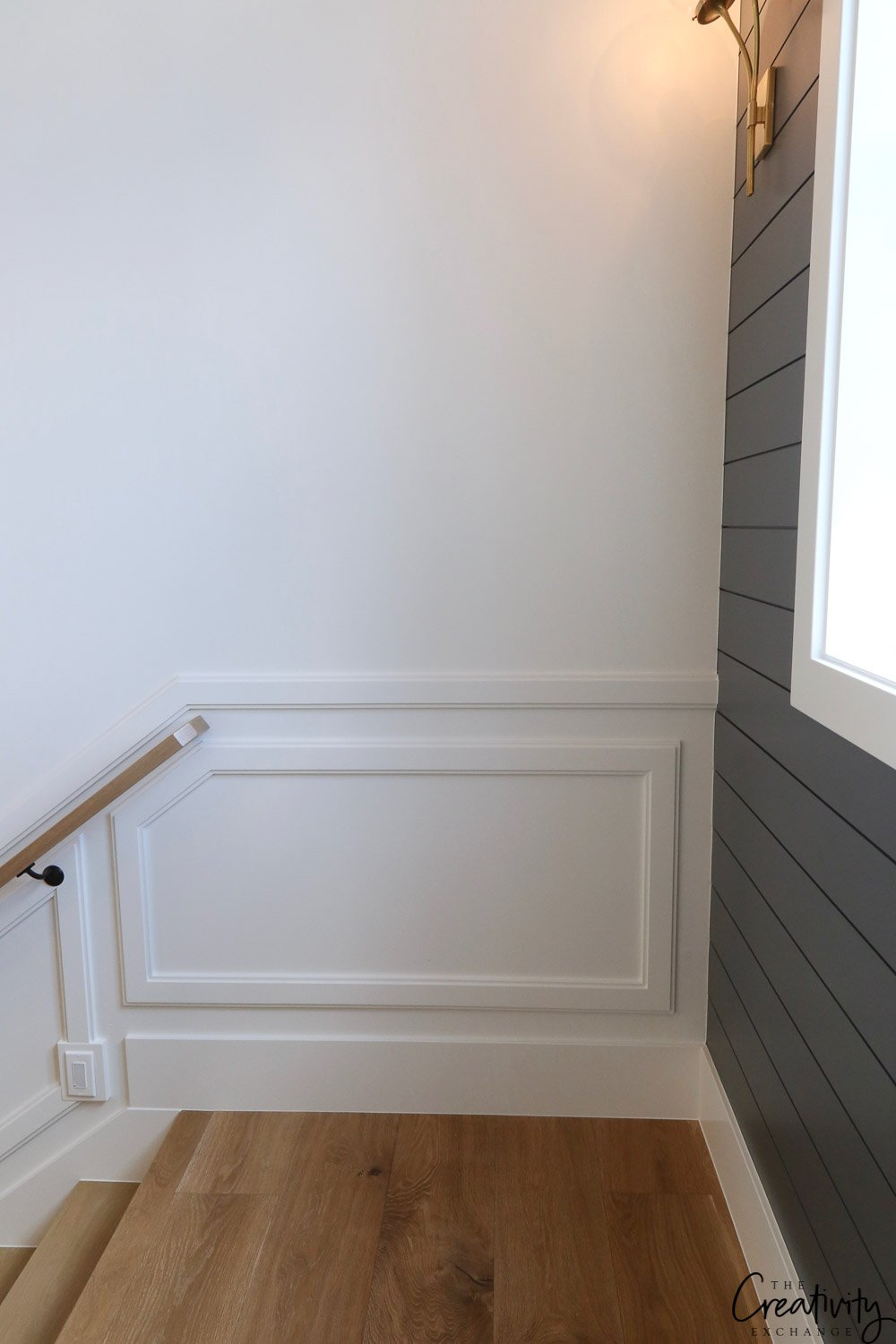 Beautiful wainscoting in stairway. Millhaven Homes