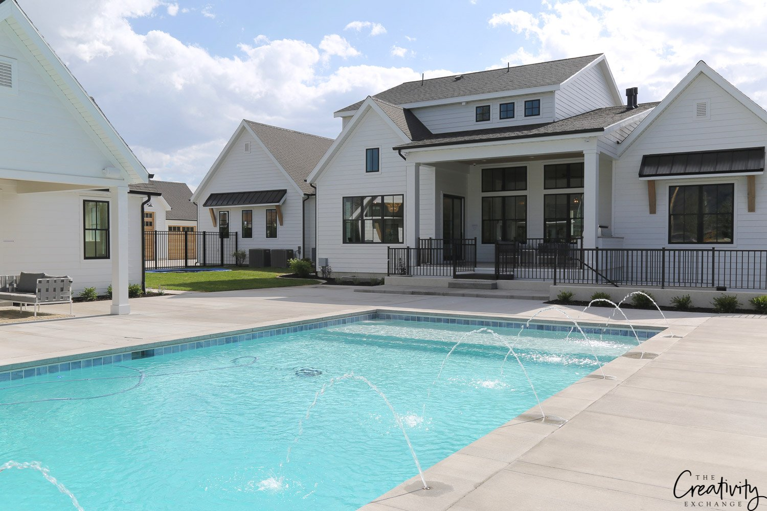 Modern Farmhouse Exterior with Pool. Millhaven Homes