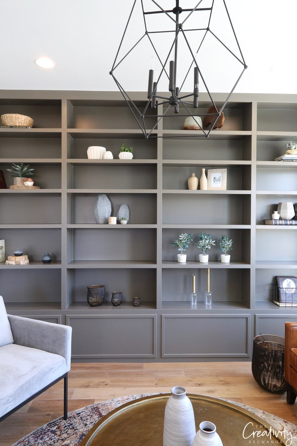 Bookshelves painted in SW Porpoise. Millhaven Homes