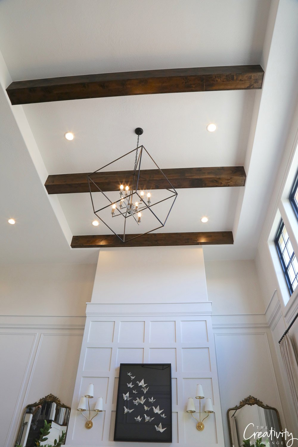 Tall open living ceilings with beams.