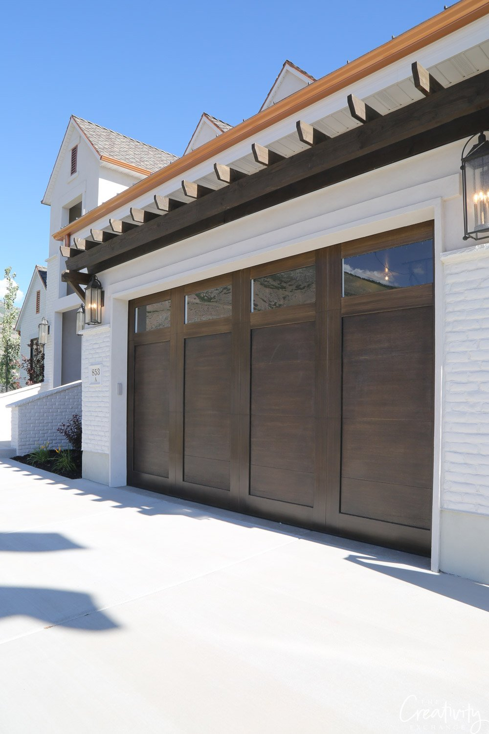 Dark wood garage door. Arive Homes