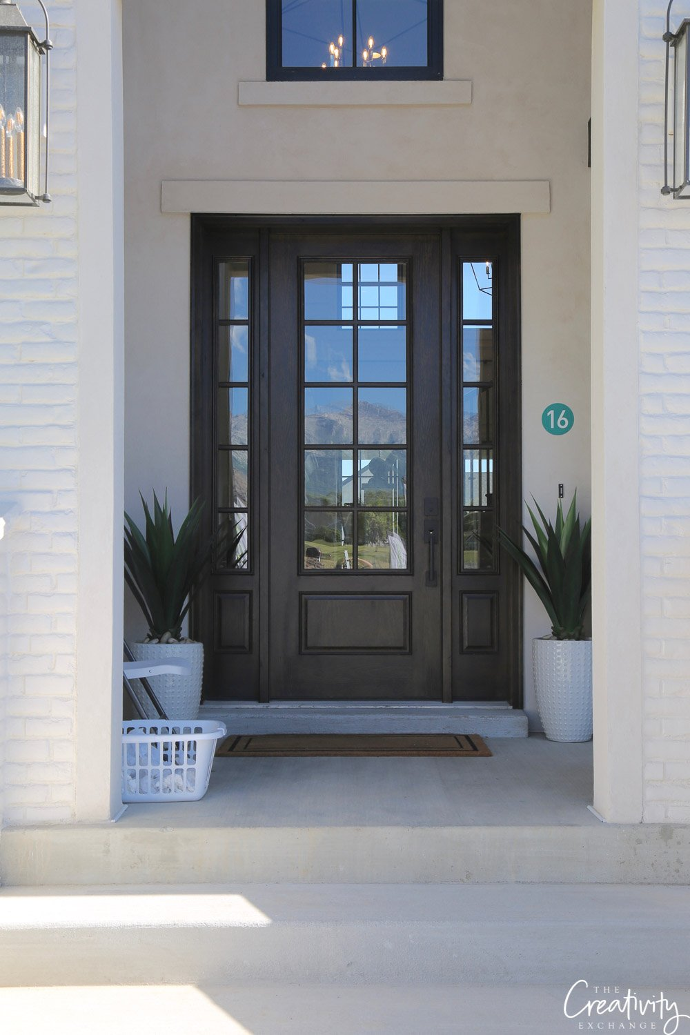 Dark wood front door. Arive homes.