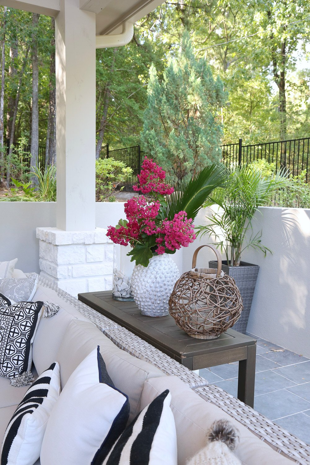 Use large vases with flower clippings from yard for outdoor decor.