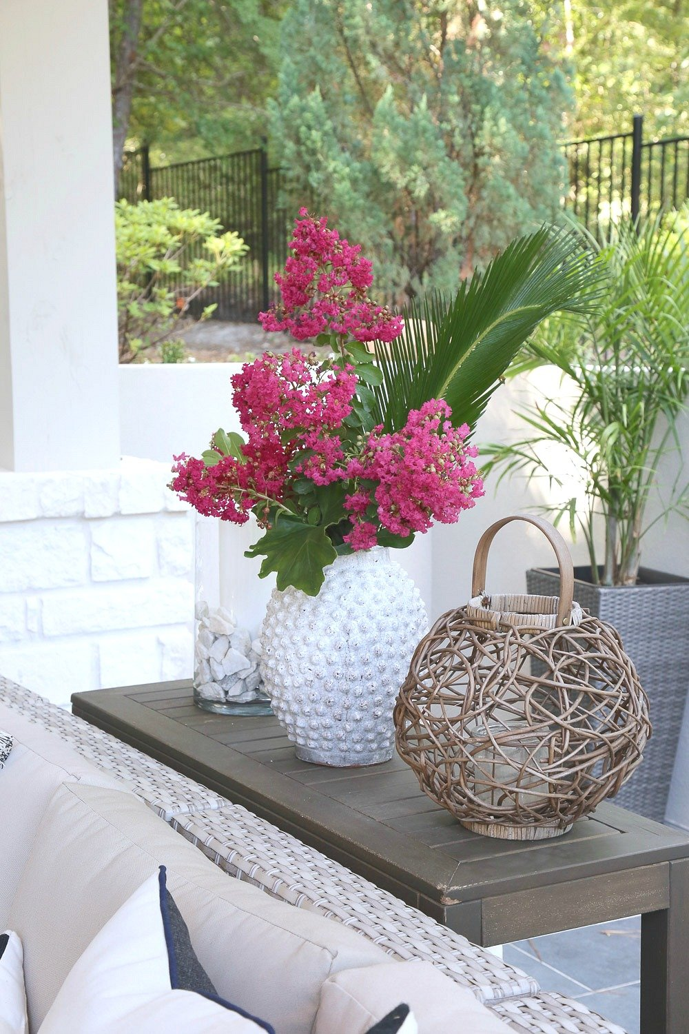 Fill vases with flower clippings for outdoor decor.