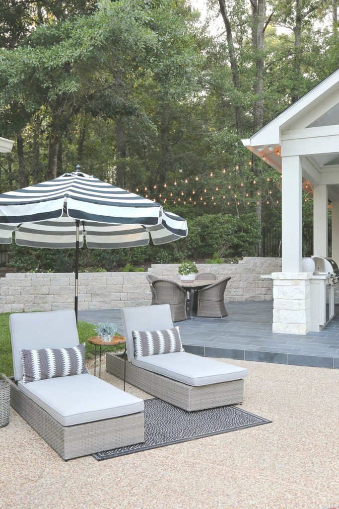 Outdoor patio with chaise lounges and umbrella