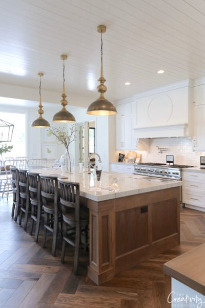 Modern farmhouse kitchen with oak floors and cabinetry.