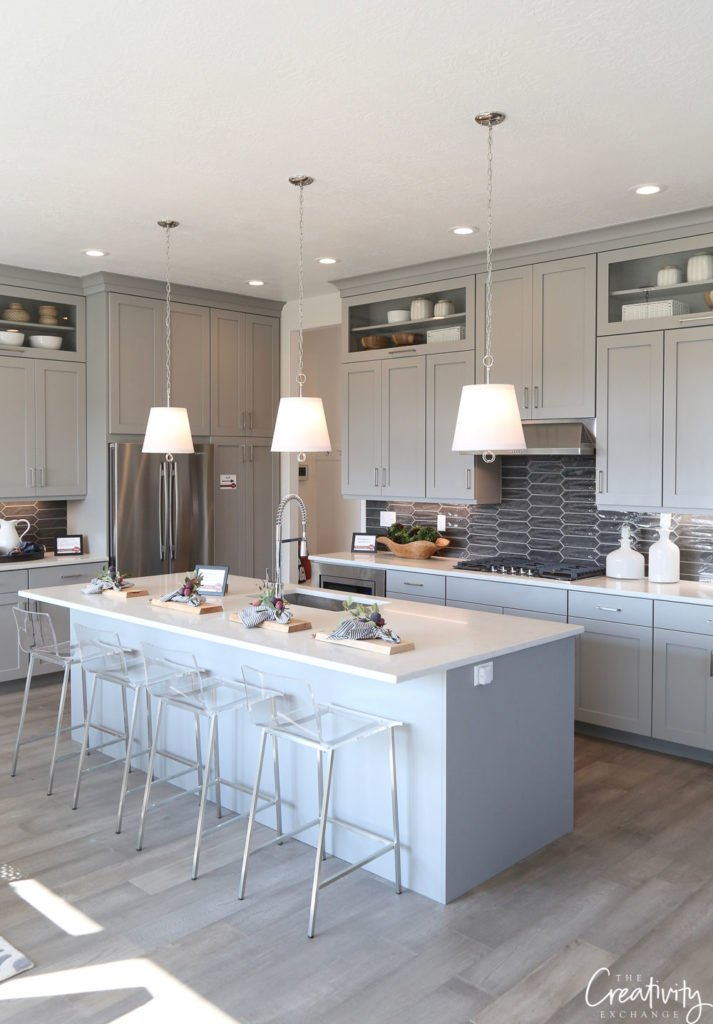 Open kitchen with painted gray cabinets.