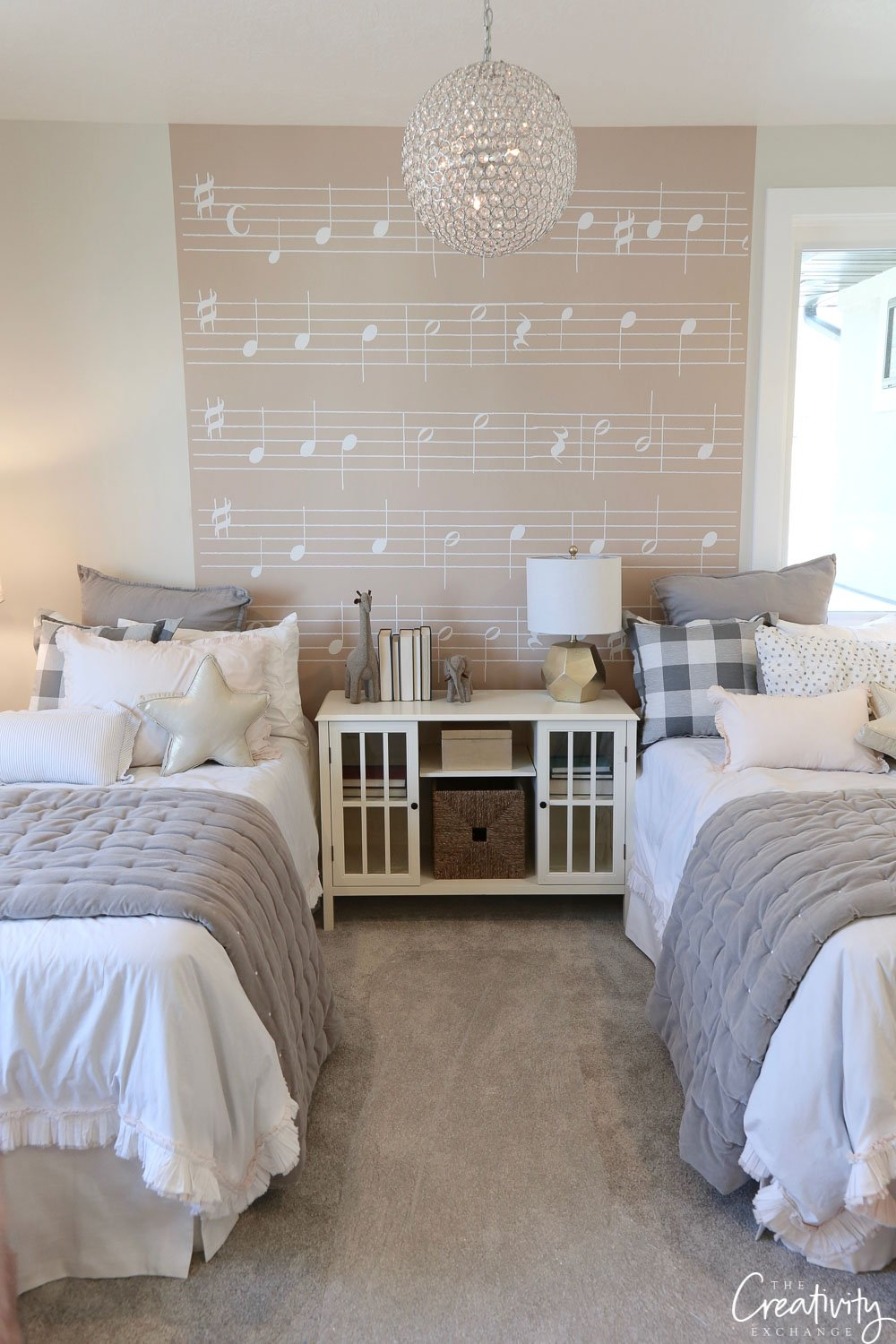 Twin room with sheet music mural