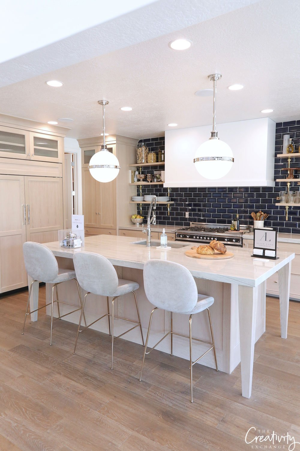 White kitchen with navy tile