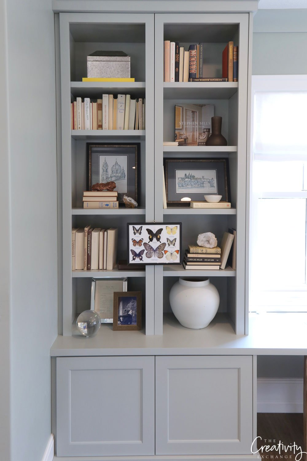 Blue/gray painted bookshelves.