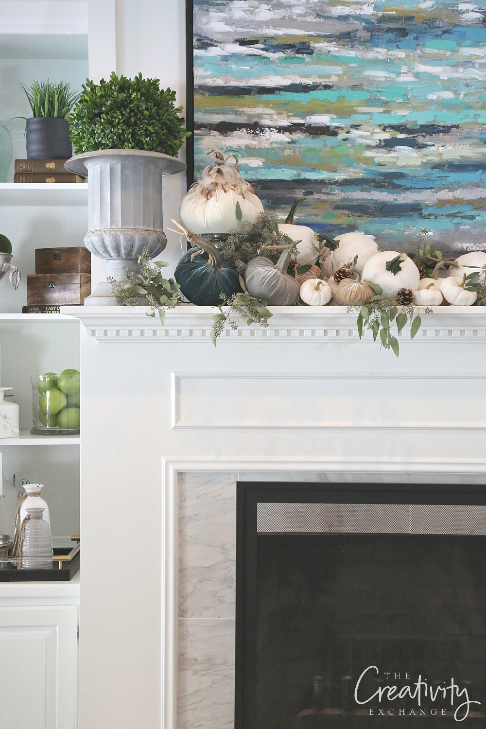 Fall mantle decorating with white and velvet pumpkins