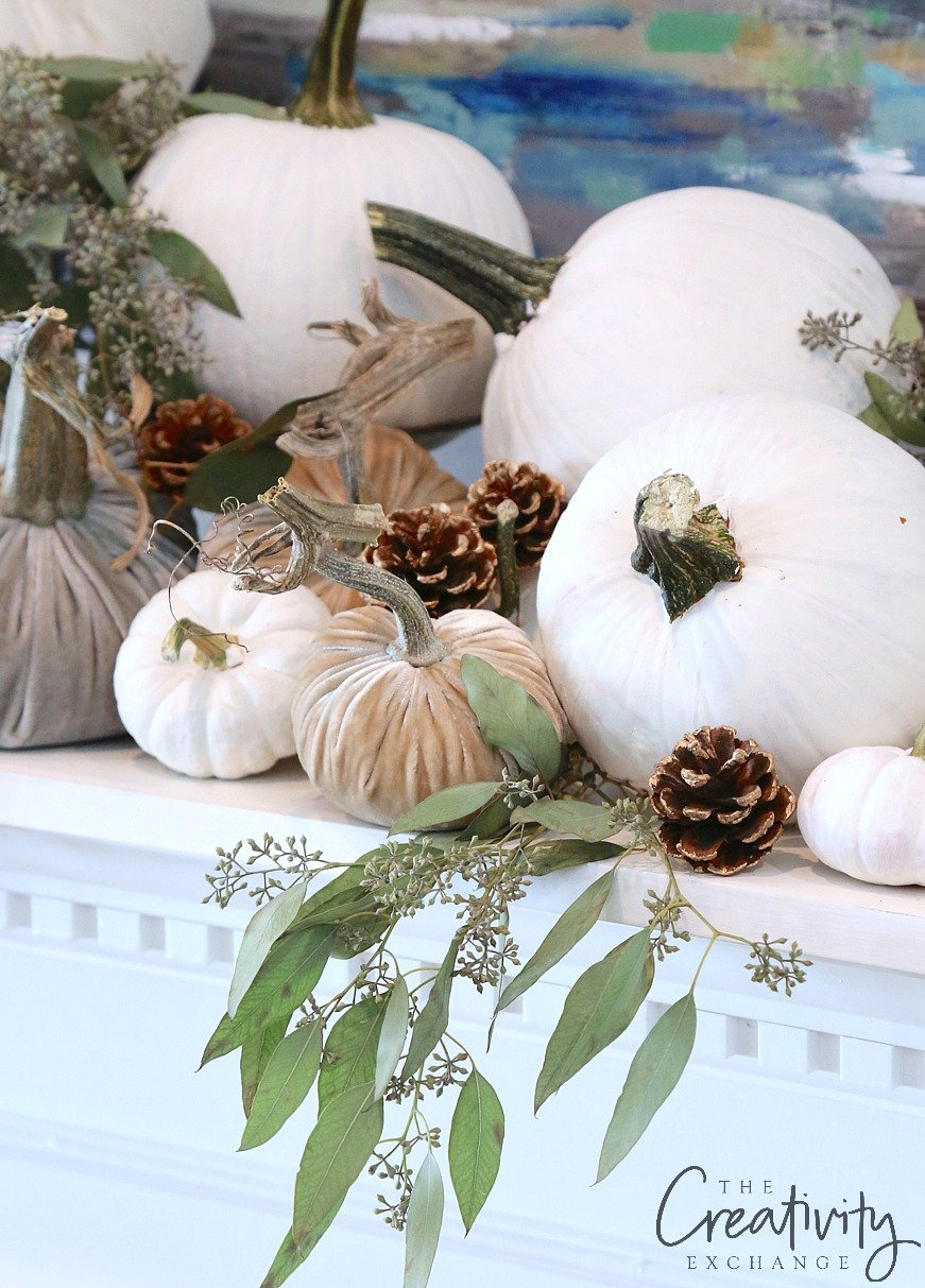 Mantle with fall white and velvet pumpkins