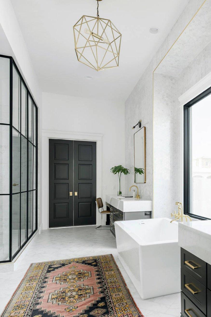 Black interior bathroom door via Cambria
