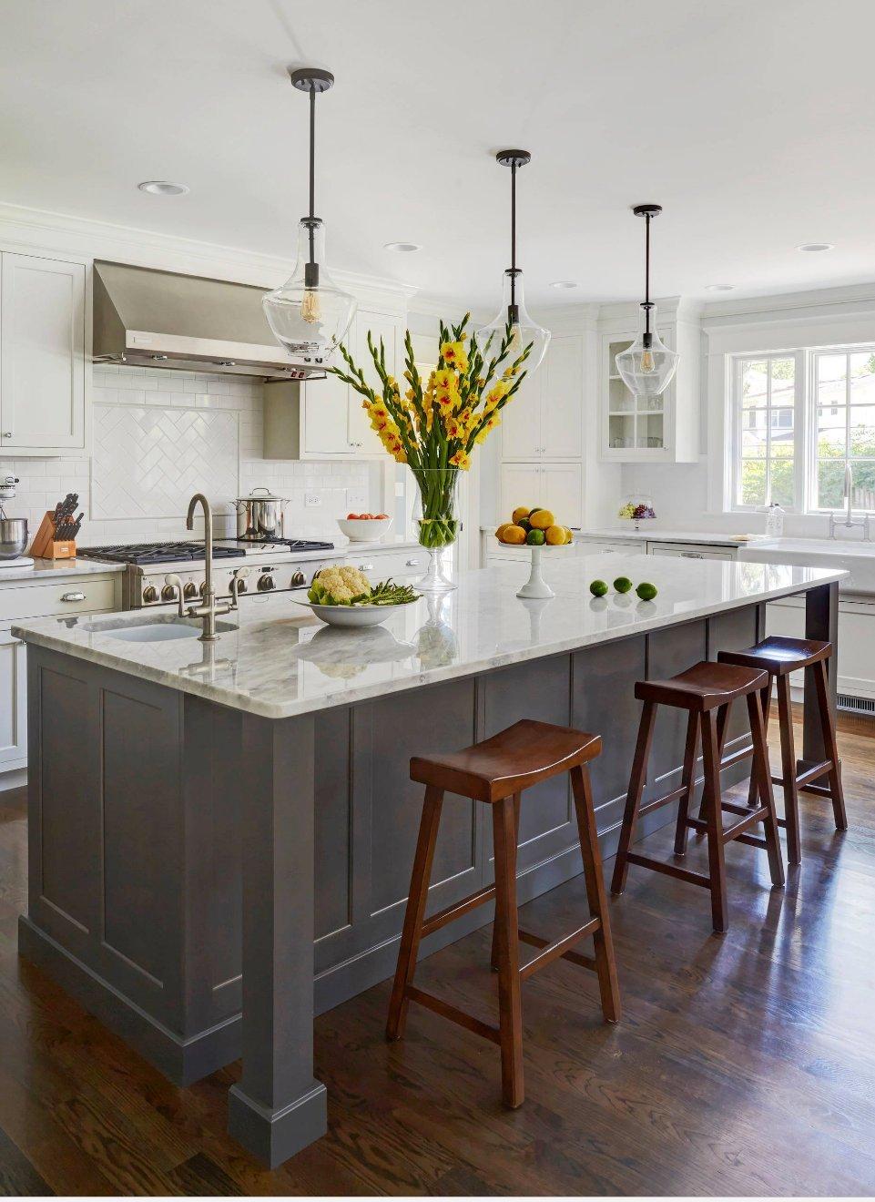 White kitchen with dark brown island