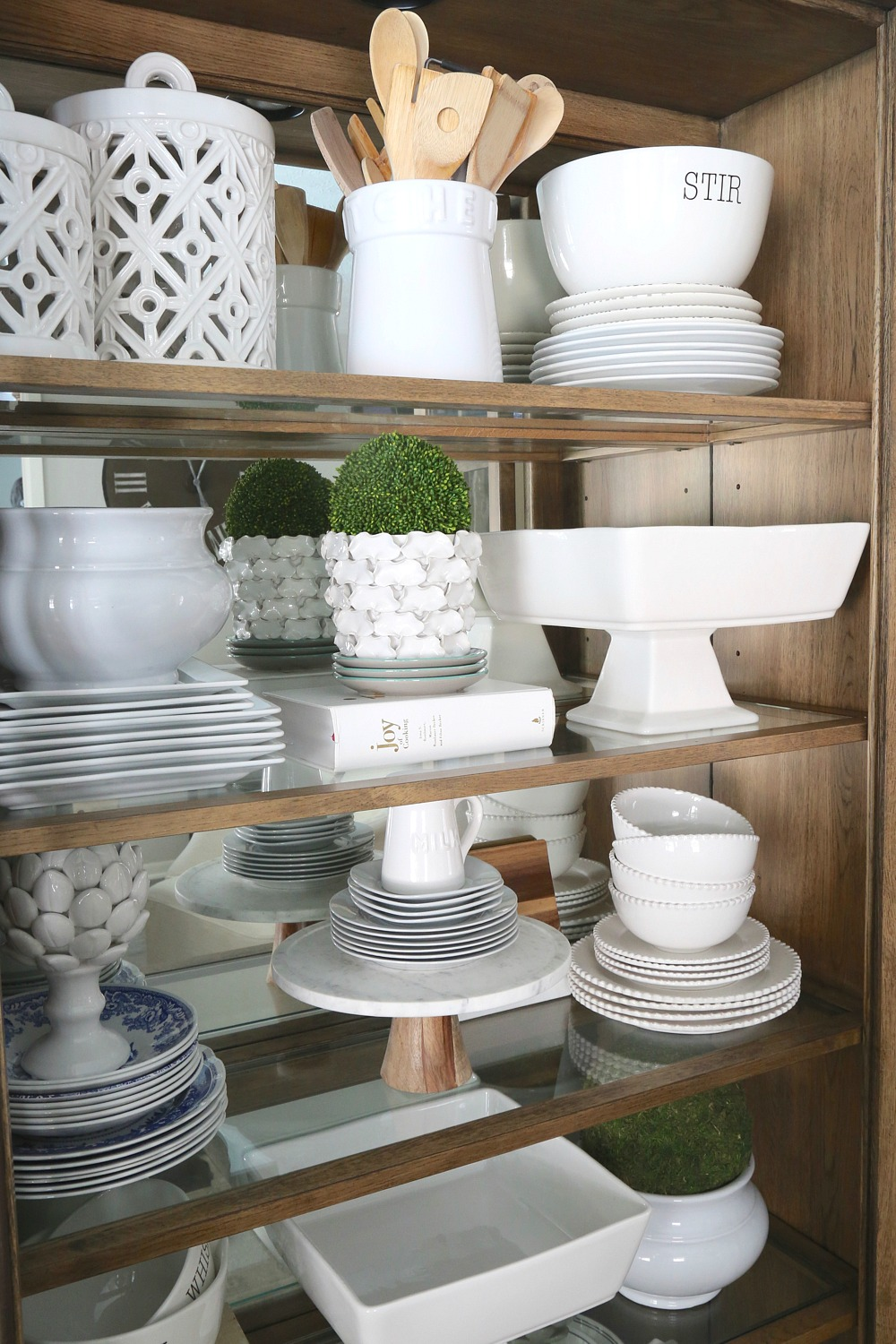 Stacking dishes in a china hutch