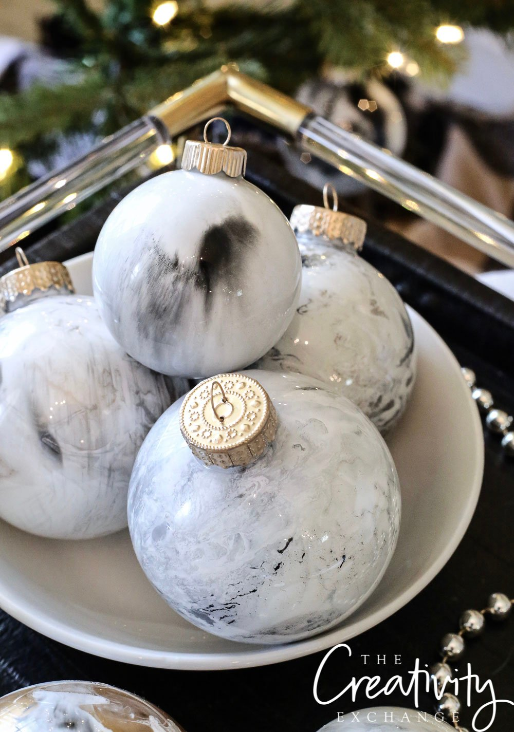 DIY Marbleized Christmas Ornaments Using Testors Paint.