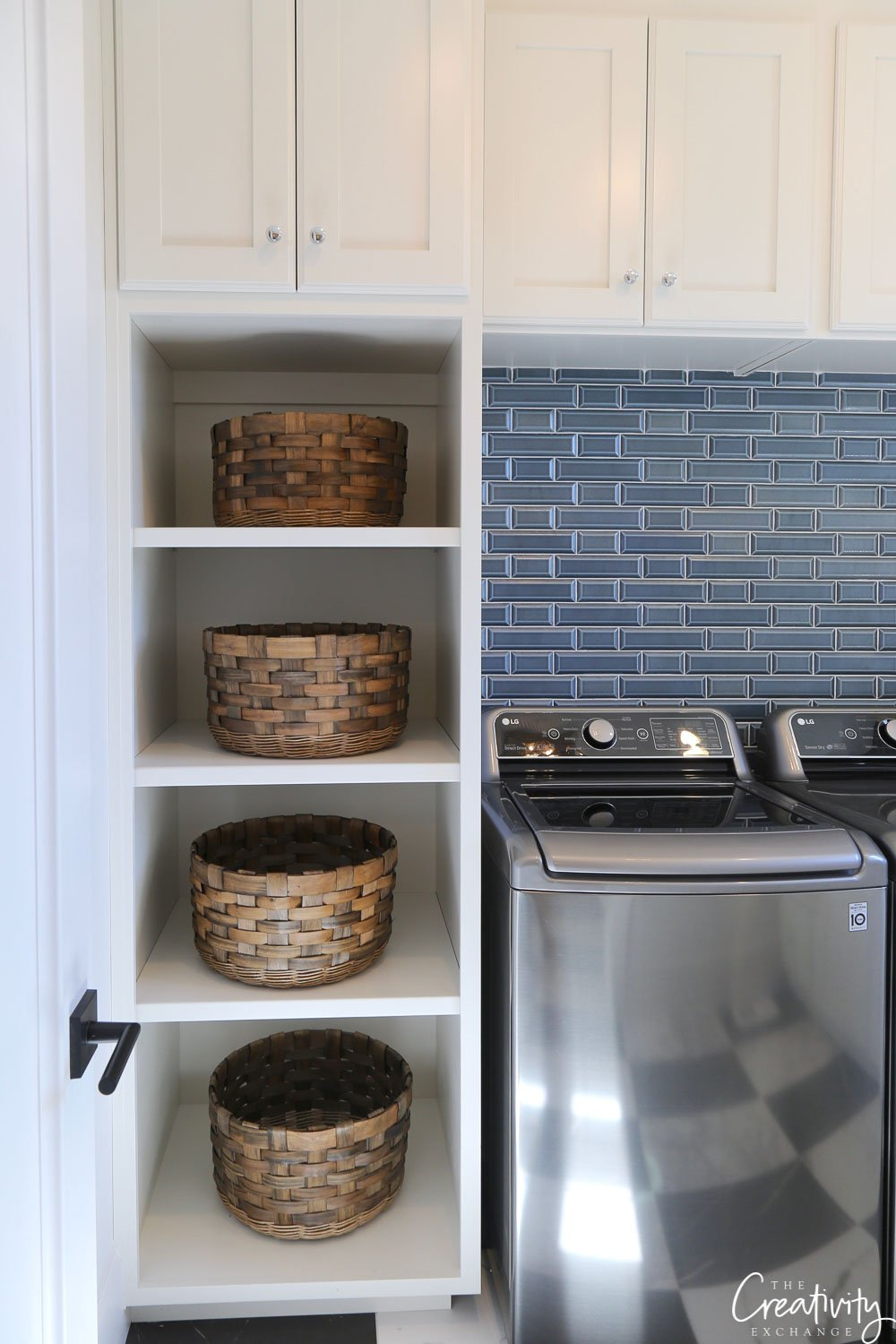 Navy tile laundry room backsplash