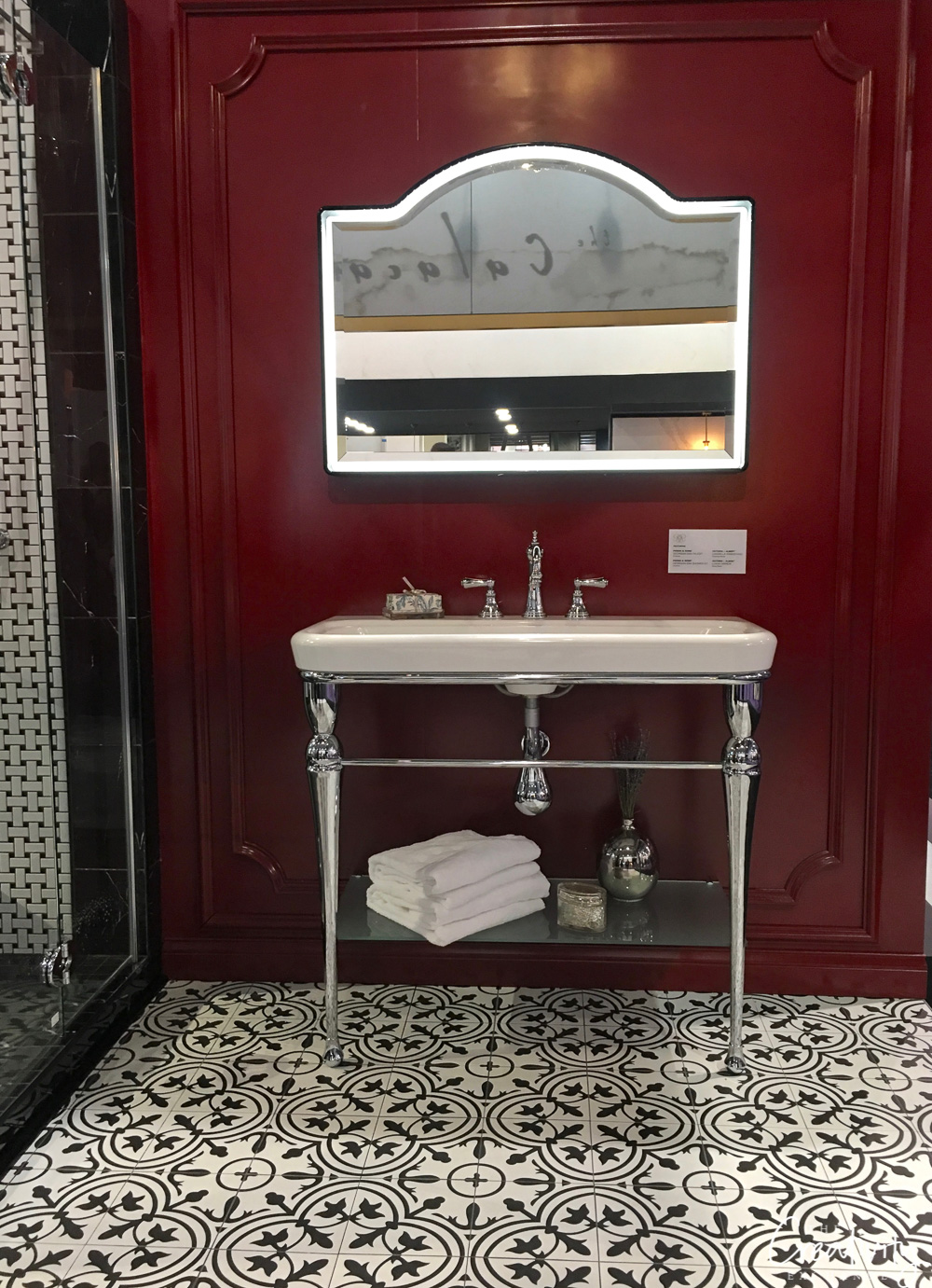 Bathroom sink mixed with black and white cement floor