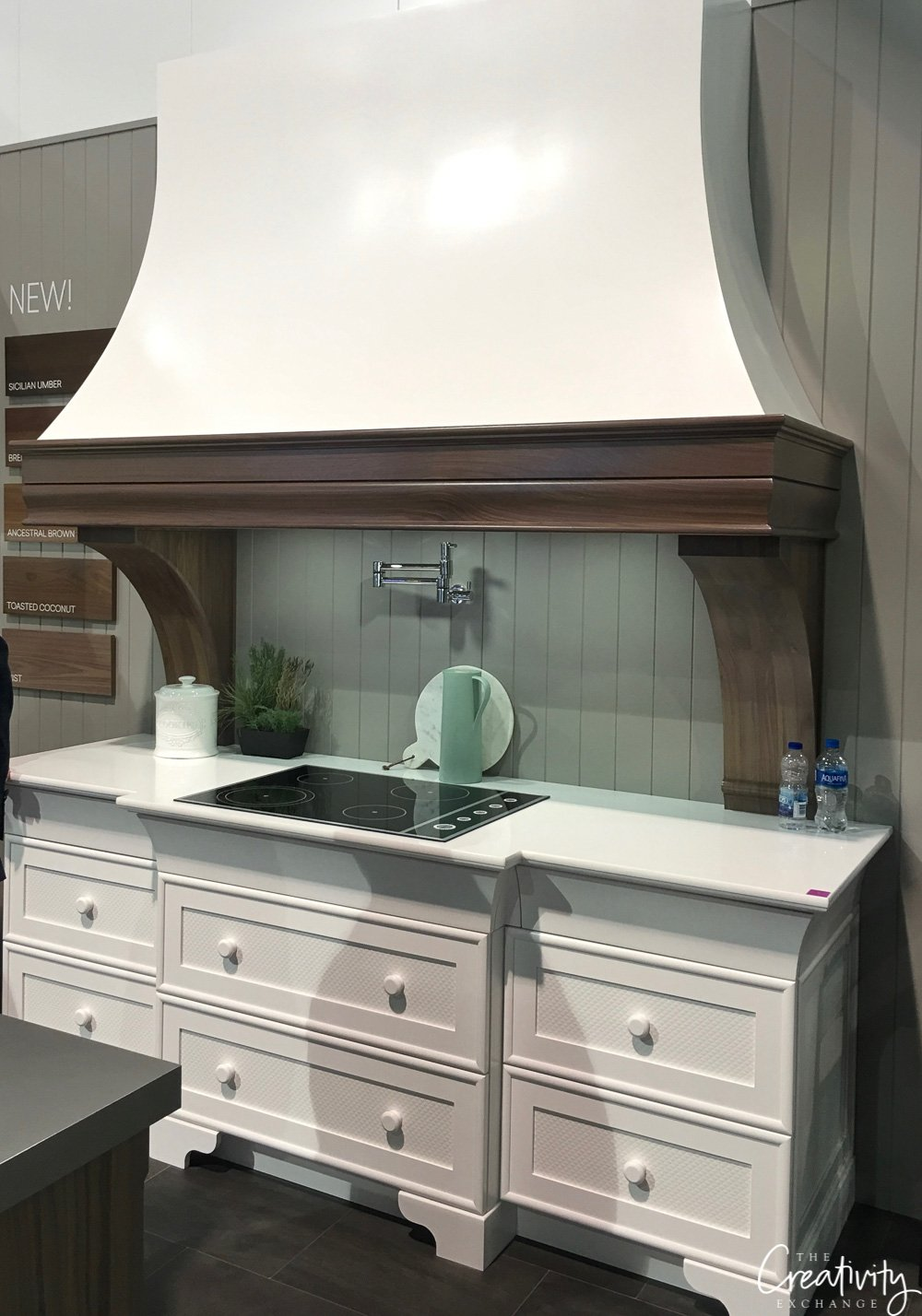 Kitchen cabinetry and hood