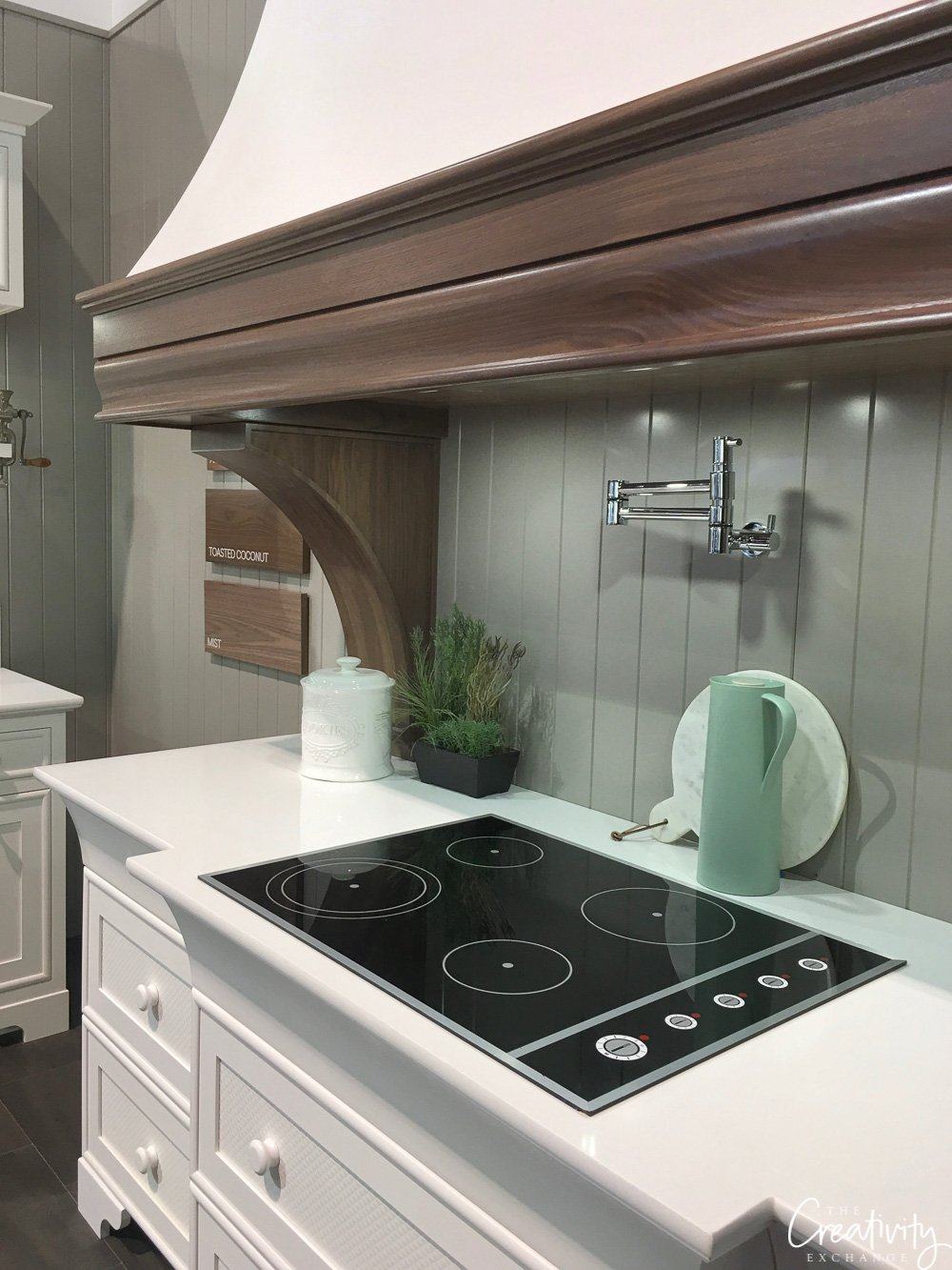 Custom cabinetry and wood vent hood