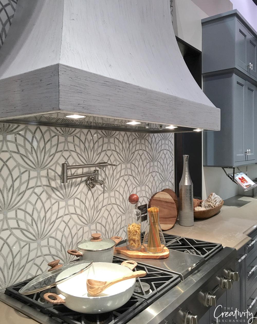 Elkay kitchen with Artistic Tile mosaic backsplash.
