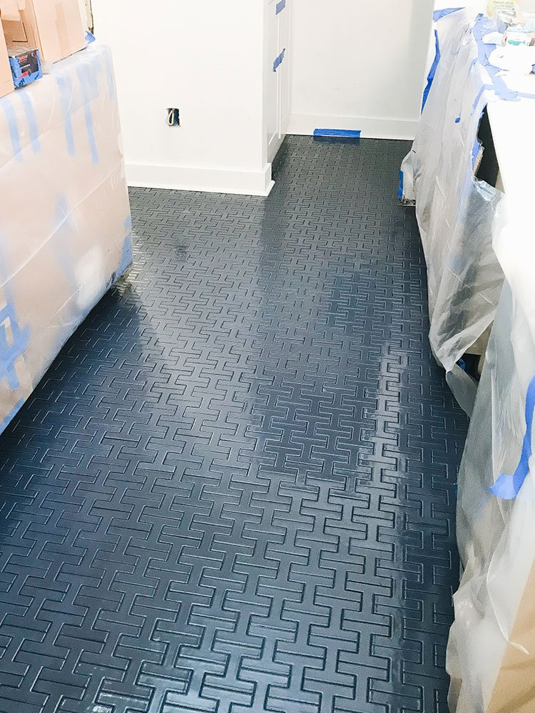 Navy floor tile in kitchen