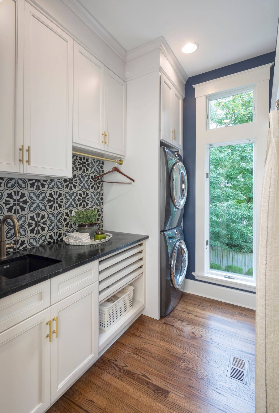 navy patterned wall tiles in laundry room