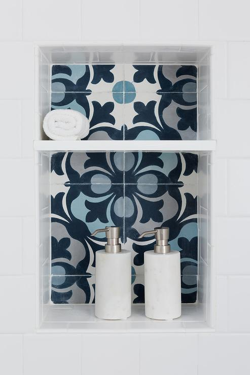 Blue cement patterned tile in shower niche
