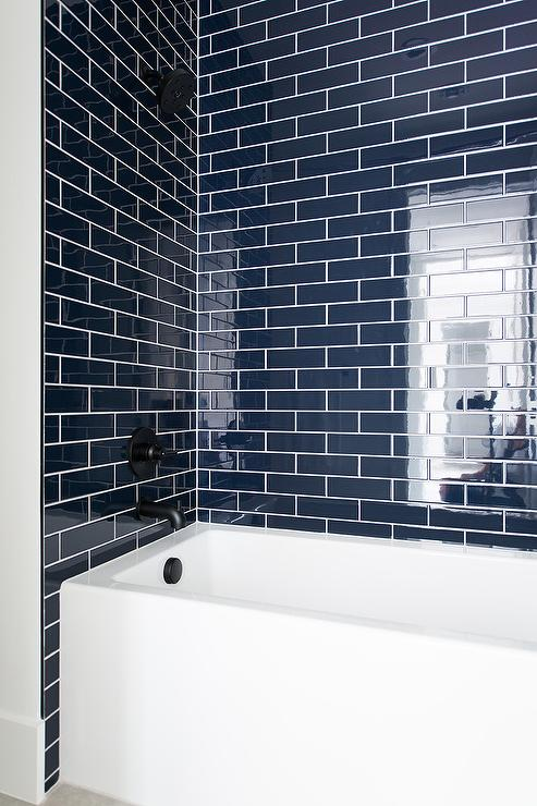 navy-blue-tiles-with-white-drop-in-bathtub