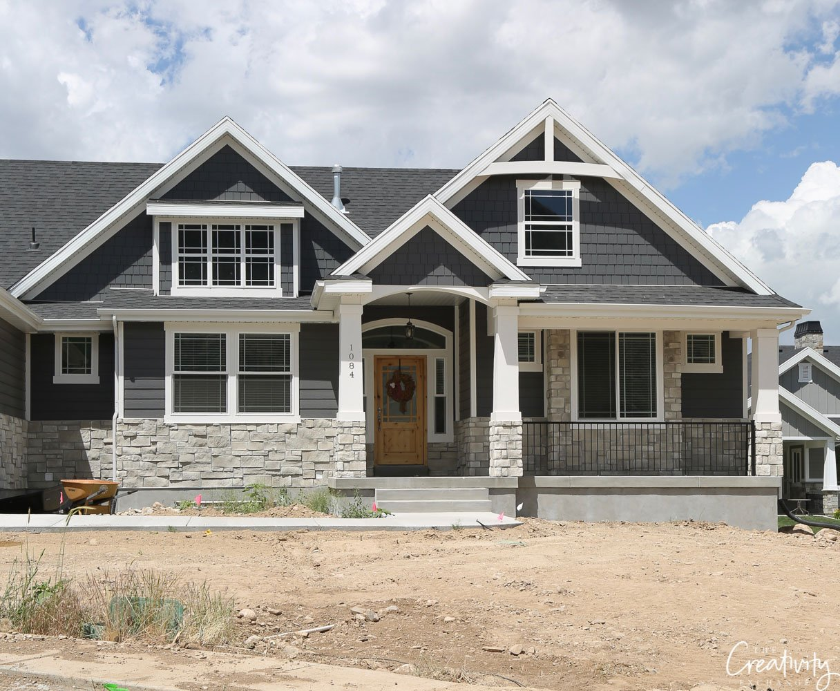 Dark exterior home with stone accents