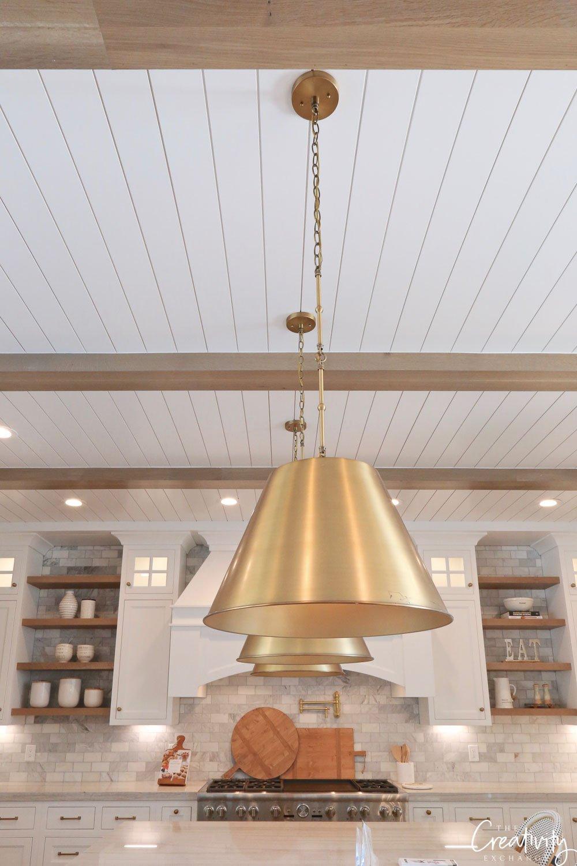 Polished brass pendant lights