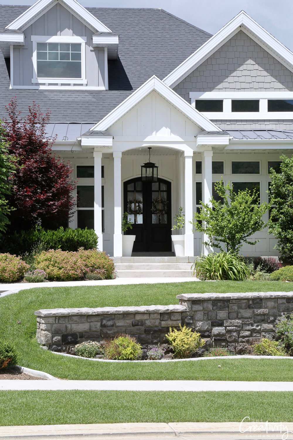 Traditional exterior home painted white and light gray