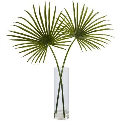 Faux fan palms in a glass vase