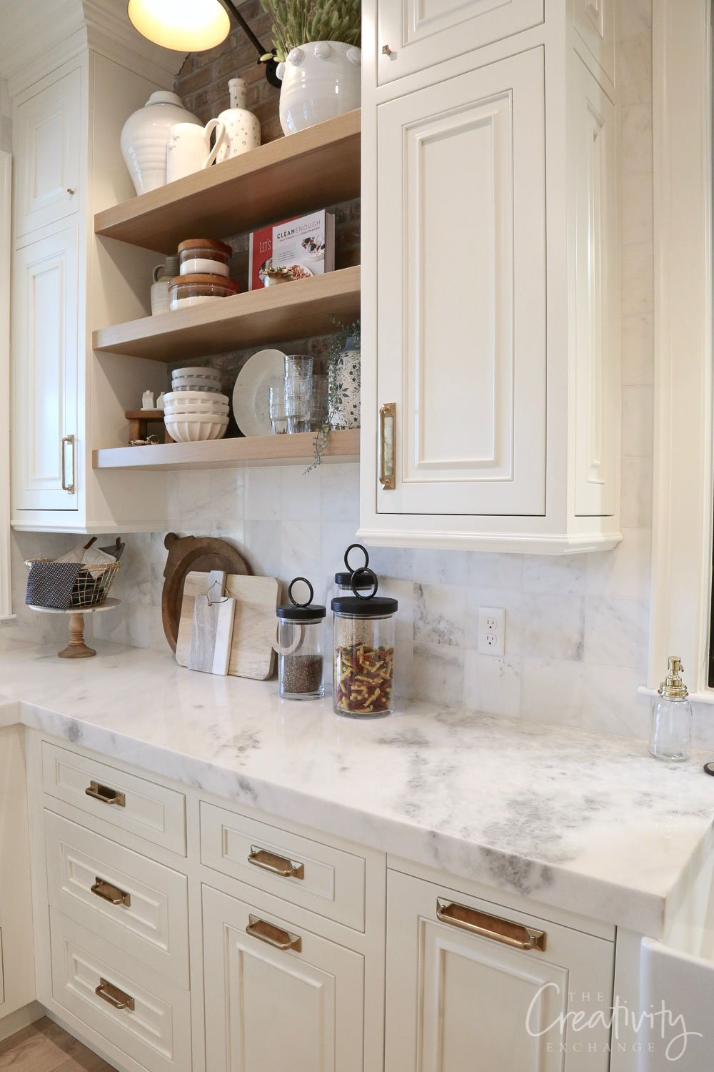 White kitchen with floating shelves