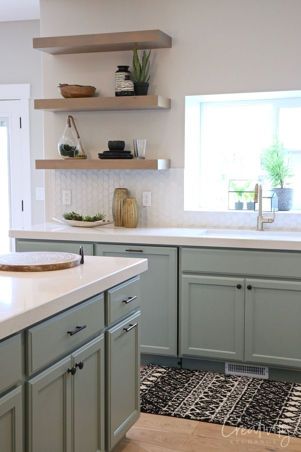 Kitchen lower cabinet color is Sherwin Williams Acacia Haze