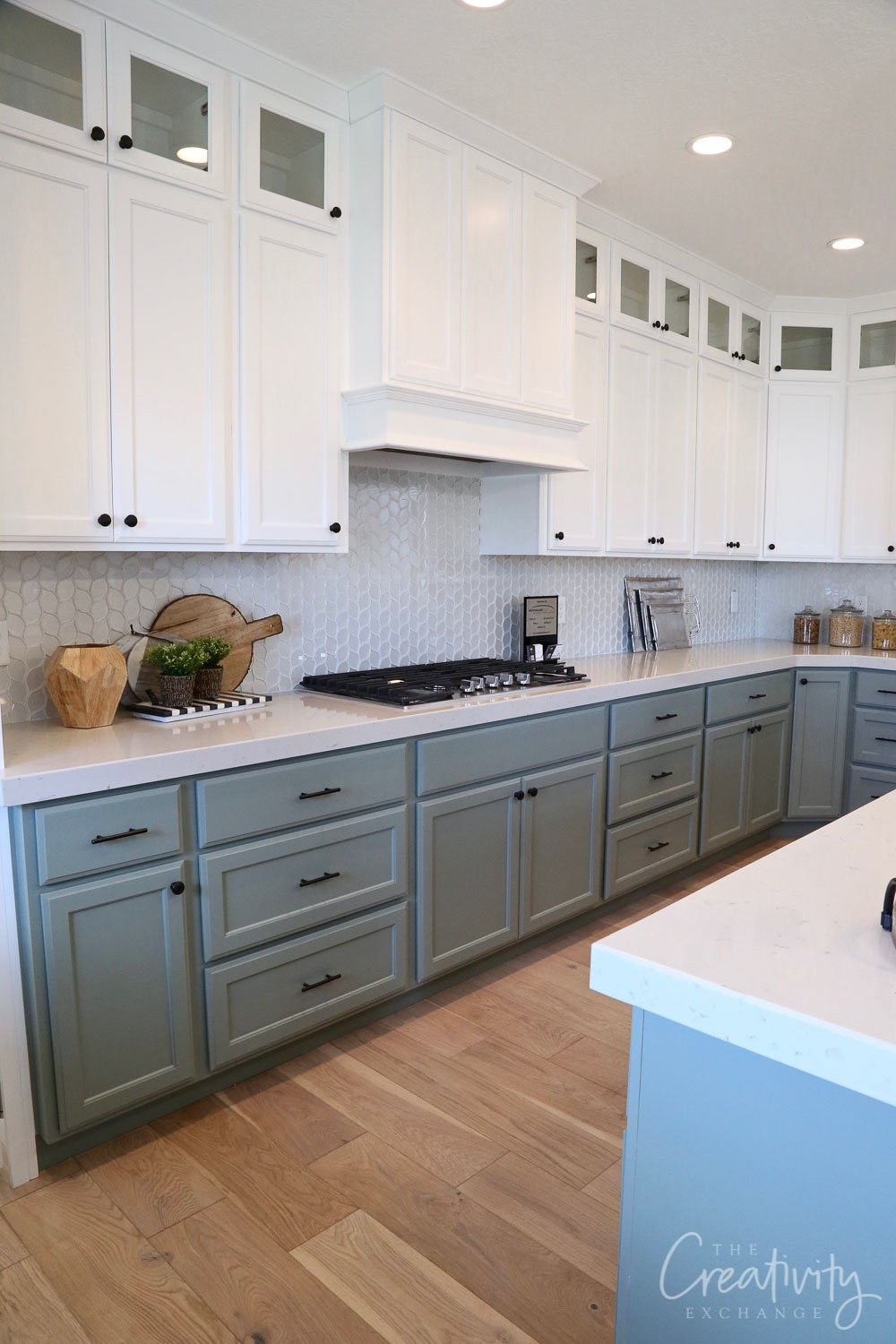 Lower cabinet paint color is Sherwin Williams Acacia Haze