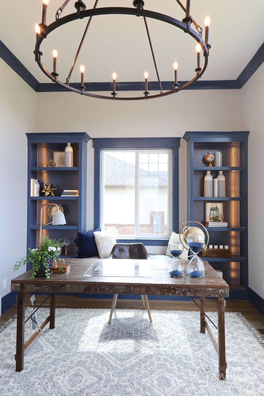Office with blue cabinetry