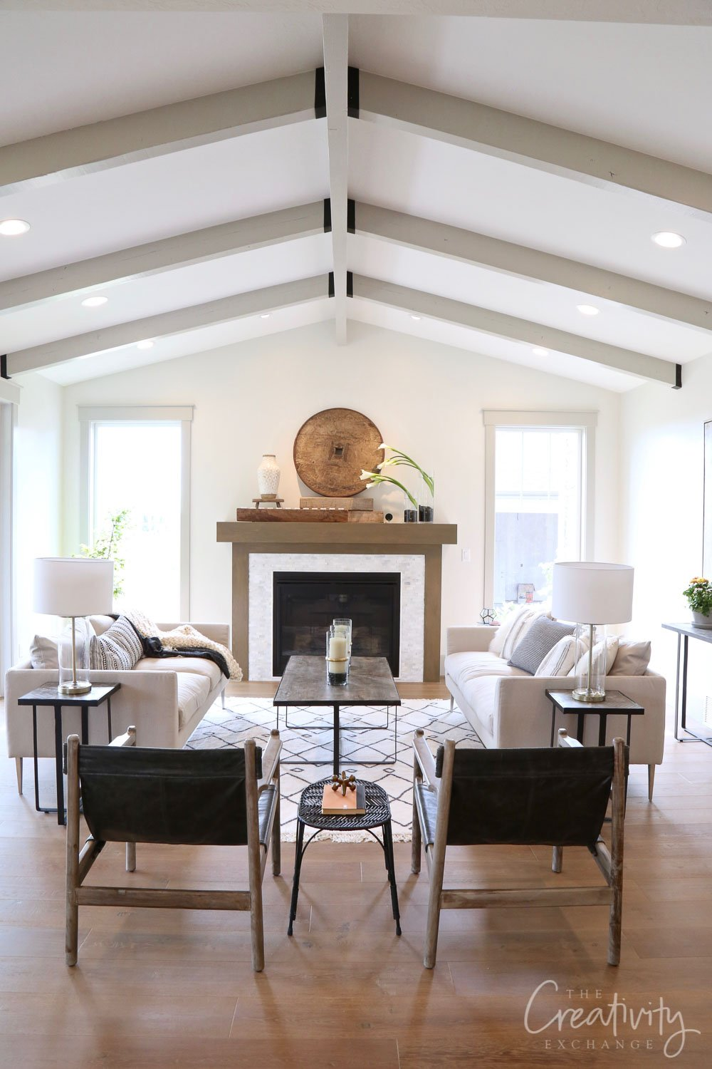 Open living room with painted ceiling beams