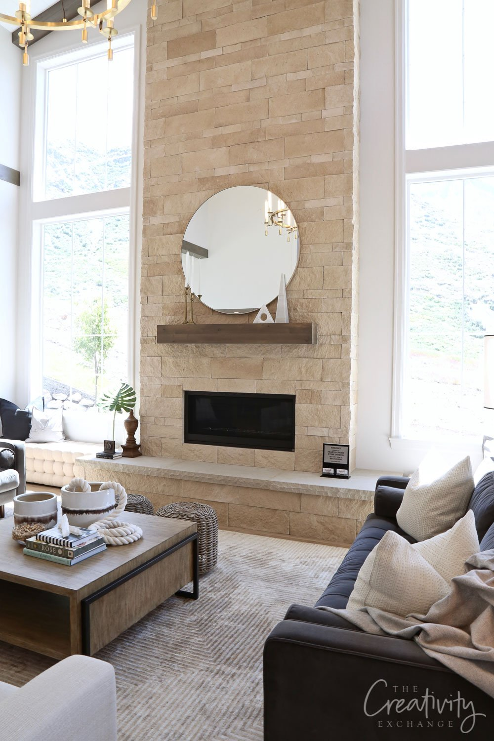 Living room with limestone fireplace