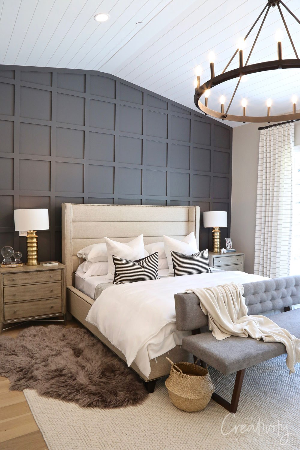 Master bedroom with dark rich grid accent wall