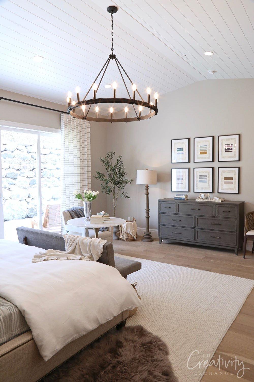 Master bedroom with wheel chandelier