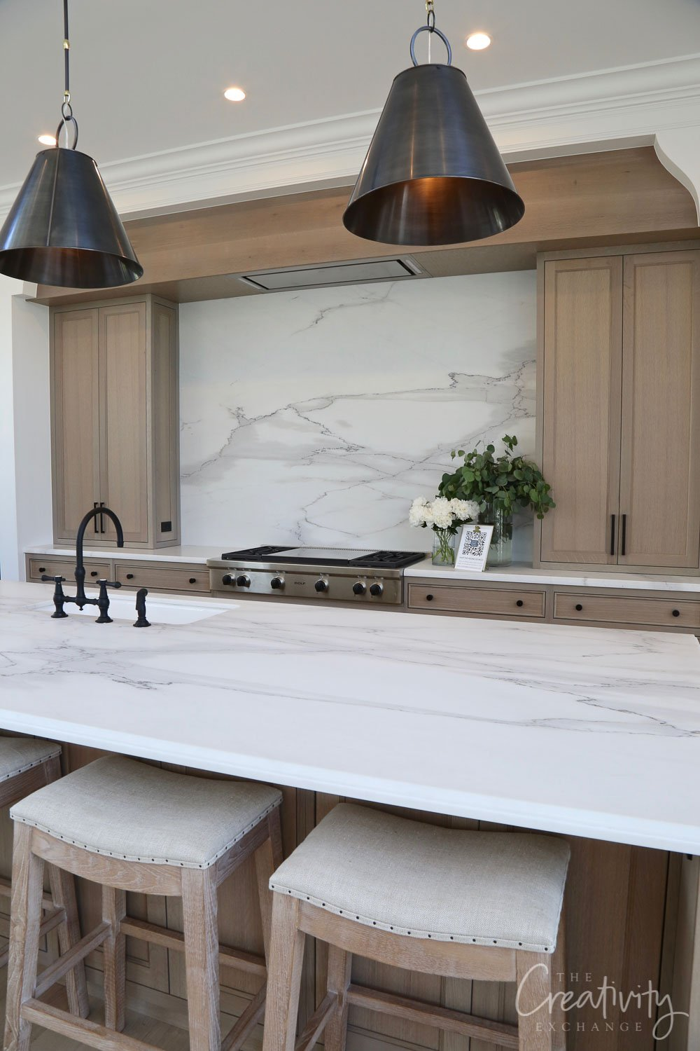 Kitchen with solid slab marble countertops and backsplash