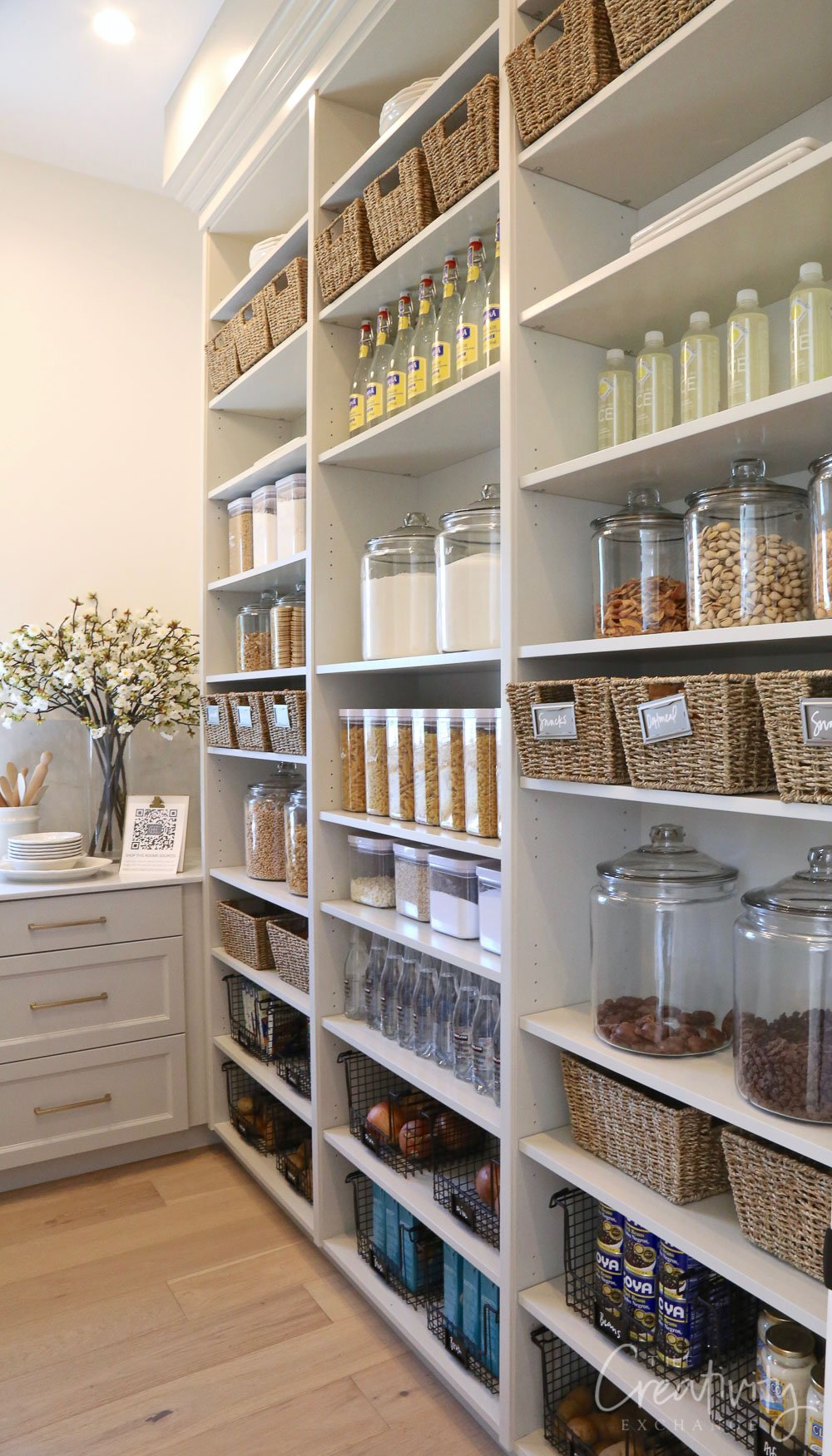 Large pantry with floor to ceiling open storage