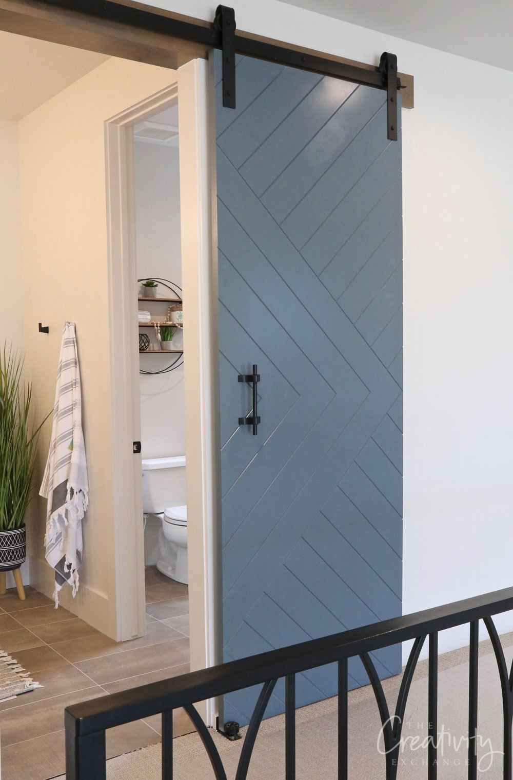 Sliding barn door painted with Sherwin Williams Slate Tile