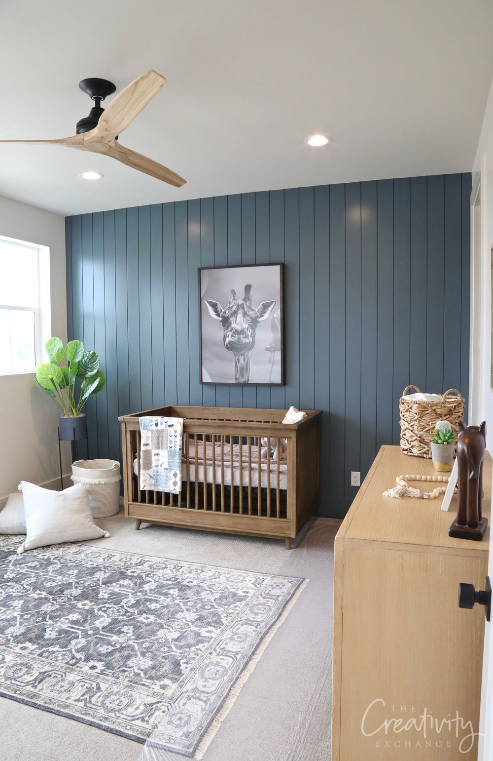 Painted shiplap accent wall painted with Sherwin Williams Slate Tile